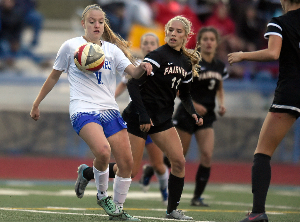 . Broomfield High School\'s Anna Bybee stops a pass in front of Skylar Anderson during a CHSAA State 5A Quarterfinal game against Fairview on Wednesday in Broomfield. Broomfield won the game 4-1. More photos: www.bocopreps.com Jeremy Papasso/ Staff Photographer/ May 17, 2017