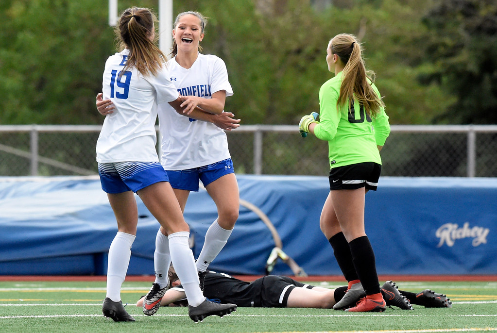 . Broomfield High School\'s Gia Lemley, at center, and Hailey Stodden celebrate a goal during a CHSAA State 5A Quarterfinal game against Fairview on Wednesday in Broomfield. Broomfield won the game 4-1. More photos: www.bocopreps.com Jeremy Papasso/ Staff Photographer/ May 17, 2017