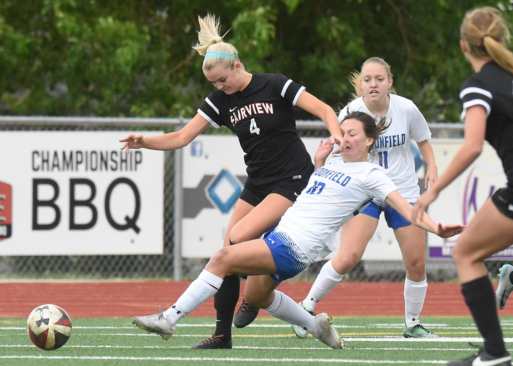 . Fairview High School\'s Tea Smith fights for the ball with Cara Quinn during a CHSAA State 5A Quarterfinal game against Broomfield on Wednesday in Broomfield. Broomfield won the game 4-1. More photos: www.bocopreps.com Jeremy Papasso/ Staff Photographer/ May 17, 2017