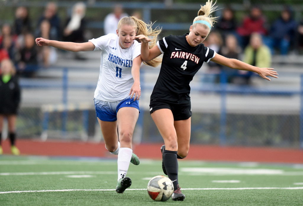 . Fairview High School\'s Tea Smith fights for the ball with Skylar Anderson during a CHSAA State 5A Quarterfinal game against Broomfield on Wednesday in Broomfield. Broomfield won the game 4-1. More photos: www.bocopreps.com Jeremy Papasso/ Staff Photographer/ May 17, 2017
