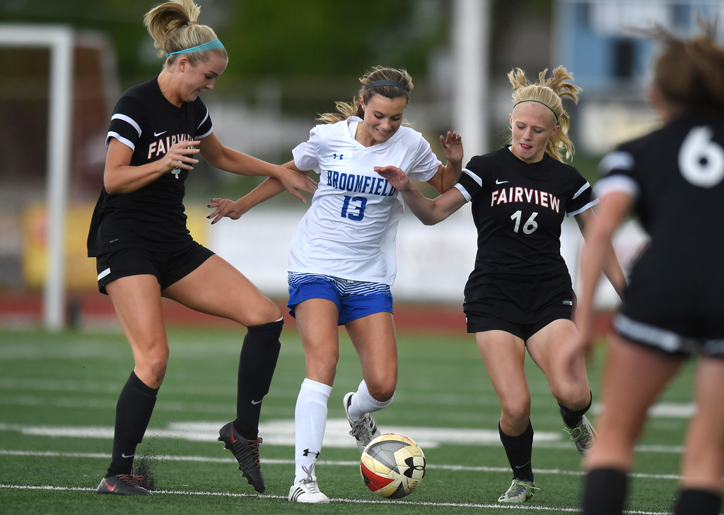 . Broomfield High School\'s Jessie Mooney moves the ball past Tea Smith, at left, and Aspen Anderson during a CHSAA State 5A Quarterfinal game against Fairview on Wednesday in Broomfield. Broomfield won the game 4-1. More photos: www.bocopreps.com Jeremy Papasso/ Staff Photographer/ May 17, 2017