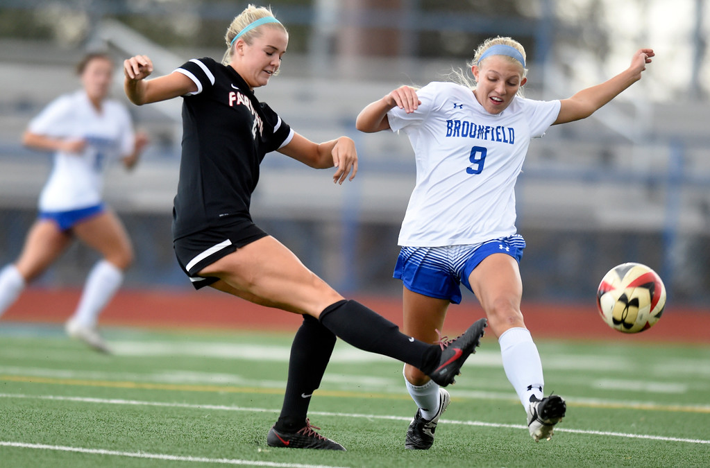 . Fairview High School\'s Tea Smith passes the ball in front of Marina Davidson during a CHSAA State 5A Quarterfinal game against Broomfield on Wednesday in Broomfield. Broomfield won the game 4-1. More photos: www.bocopreps.com Jeremy Papasso/ Staff Photographer/ May 17, 2017