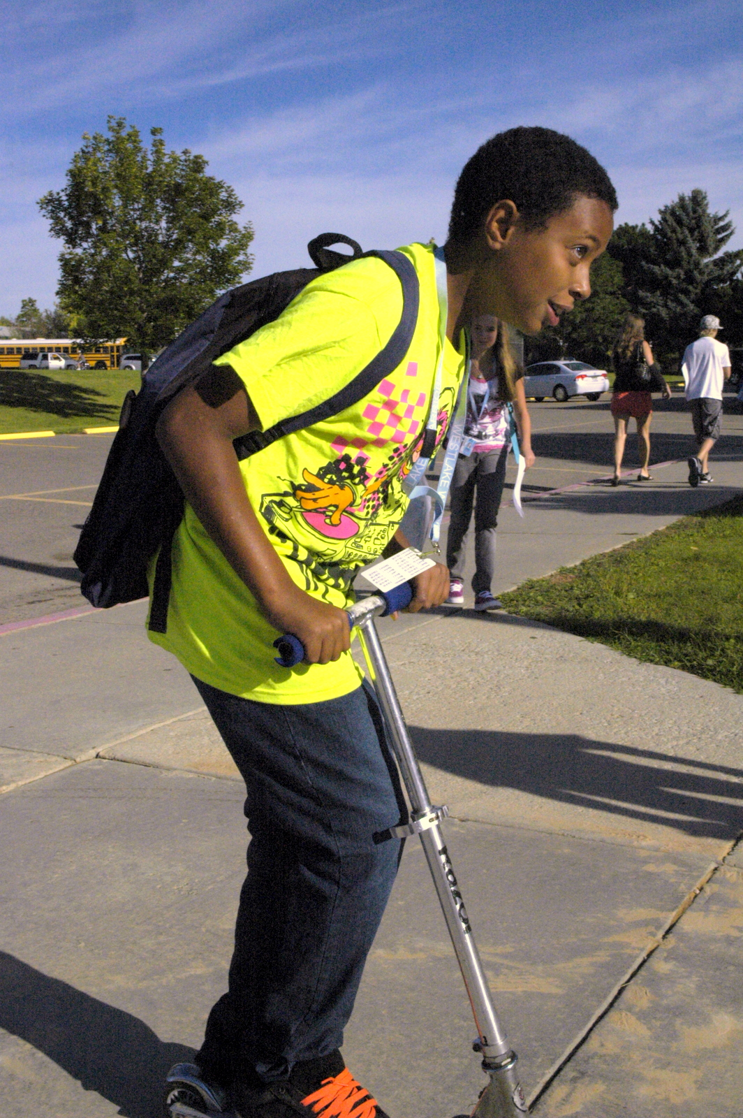 Taylor Lenord rides his scooter at Westlake Middle School's freshman orientation 08/18/10. By Dylan Otto Krider