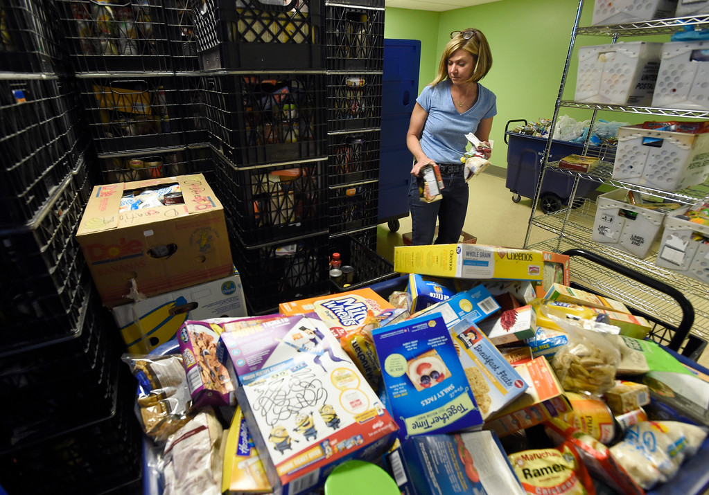 . Broomfield FISH volunteer coordinator Sharin Oliver works to stock supplies at the new Broomfield Fish Food Pantry location on Thursday in Broomfield. For more photos of crews setting up the new food pantry location go to www.dailycamera.com Jeremy Papasso/ Staff Photographer/ May 25, 2017