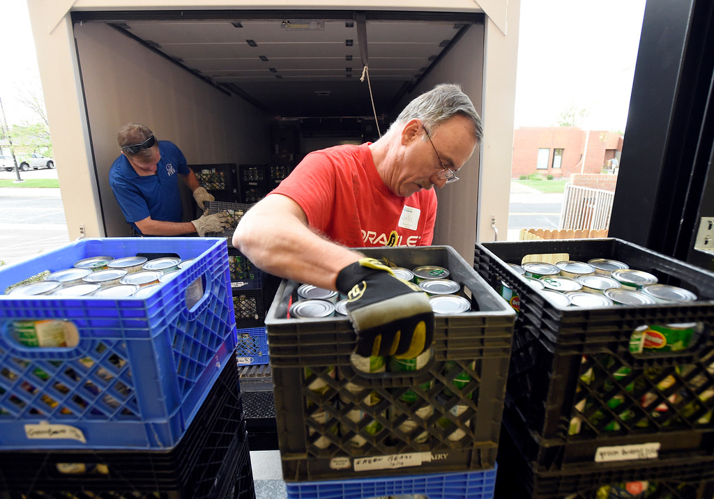 . Oracle volunteer Rich Urwiller works to unload supplies at the new Broomfield Fish Food Pantry location on Thursday in Broomfield. For more photos of crews setting up the new food pantry location go to www.dailycamera.com Jeremy Papasso/ Staff Photographer/ May 25, 2017