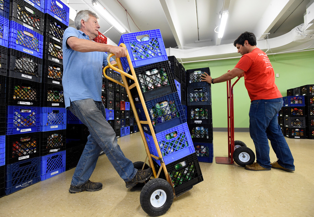 . Broomfield FISH volunteer David Massy, left, and Oracle volunteer Patricio Zambrano Garcia work to unload supplies at the new Broomfield Fish Food Pantry location on Thursday in Broomfield. For more photos of crews setting up the new food pantry location go to www.dailycamera.com Jeremy Papasso/ Staff Photographer/ May 25, 2017