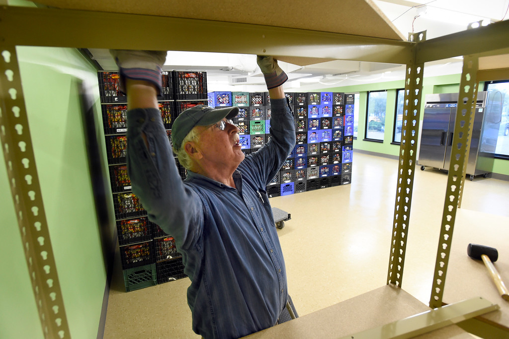 . Volunteer Dennis Kalvels works to assemble a shelf at the new Broomfield Fish Food Pantry location on Thursday in Broomfield. For more photos of crews setting up the new food pantry location go to www.dailycamera.com Jeremy Papasso/ Staff Photographer/ May 25, 2017