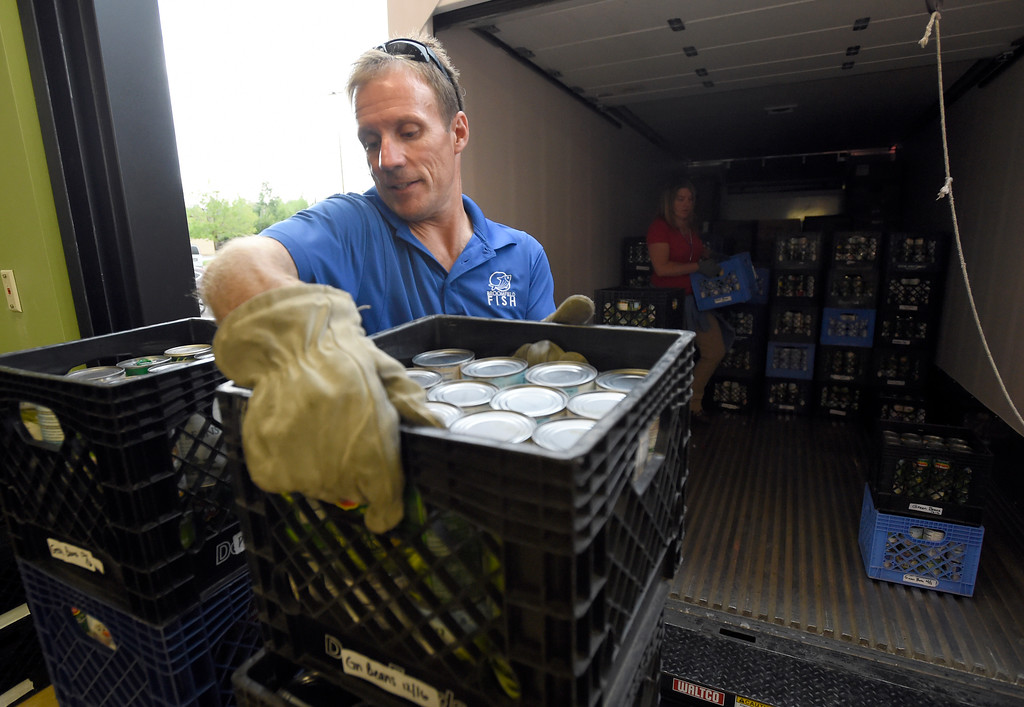 . Broomfield FISH food pantry manager Mike Lutz volunteer works to unload supplies at the new Broomfield Fish Food Pantry location on Thursday in Broomfield. For more photos of crews setting up the new food pantry location go to www.dailycamera.com Jeremy Papasso/ Staff Photographer/ May 25, 2017