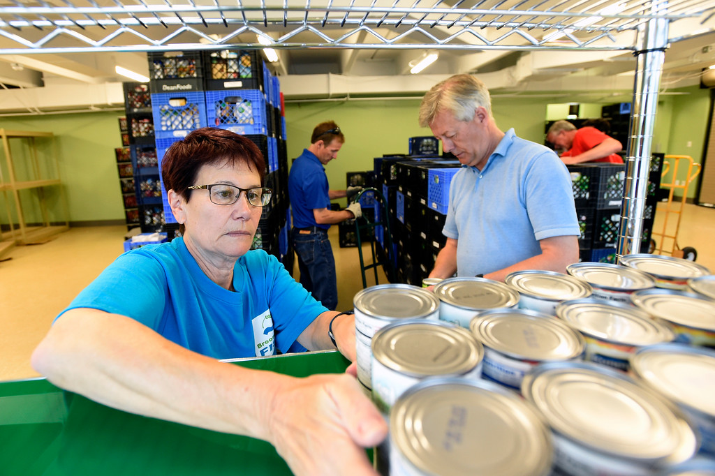 . Broomfield FISH volunteer Eleanor Edwards, left, and David Massy work to stock supplies on a shelf at the new Broomfield Fish Food Pantry location on Thursday in Broomfield. For more photos of crews setting up the new food pantry location go to www.dailycamera.com Jeremy Papasso/ Staff Photographer/ May 25, 2017