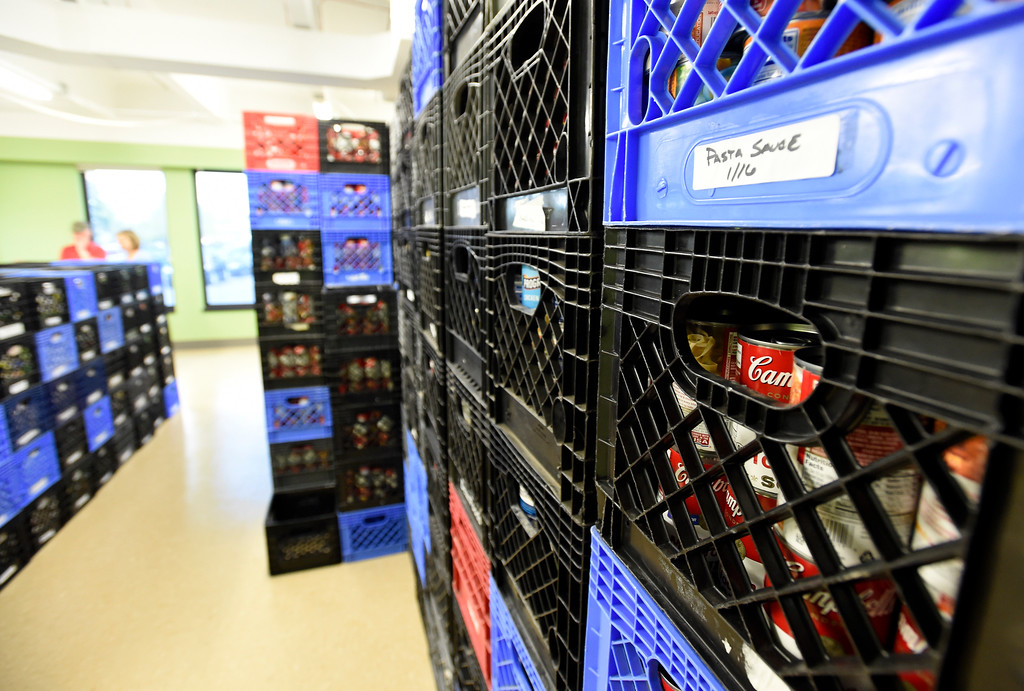 . Stacks of food at the new Broomfield Fish Food Pantry location on Thursday in Broomfield. For more photos of crews setting up the new food pantry location go to www.dailycamera.com Jeremy Papasso/ Staff Photographer/ May 25, 2017