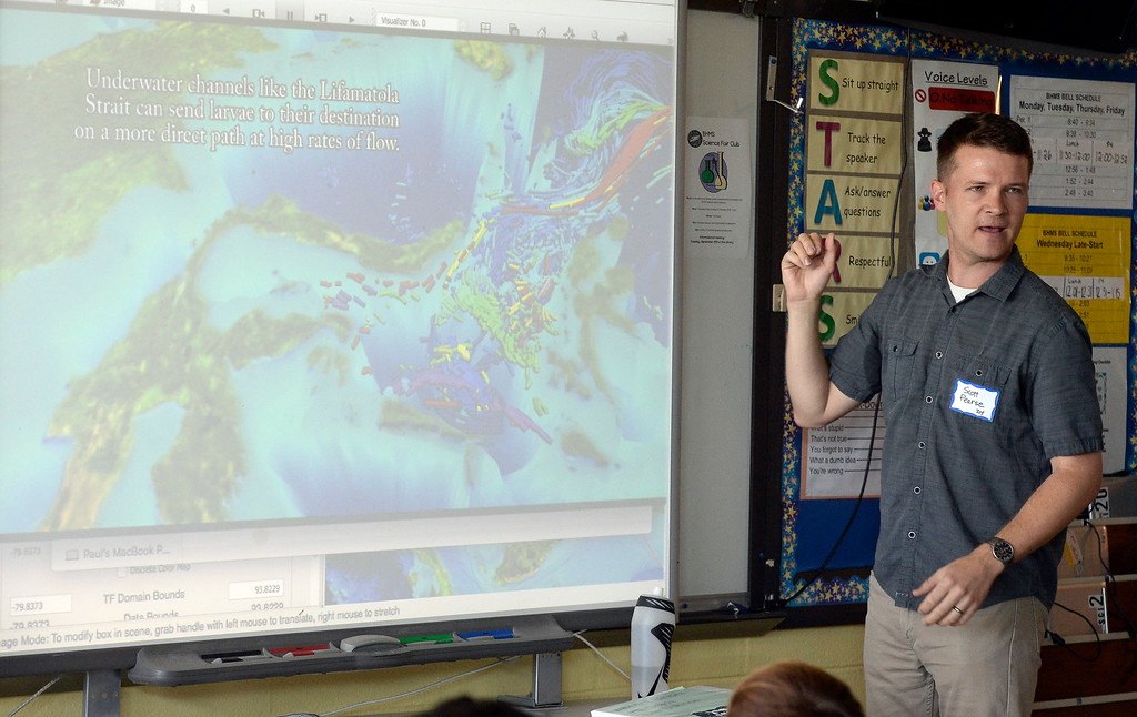 . BROOMFIELD, CO - October 2: Scott Pearse uses diagram of indonesia to talk about his work. About 60 speakers talked to sixth, seventh and eighth grade students at Broomfield Heights Middle School for their annual career day.(Photo by Cliff Grassmick/Staff Photographer))
