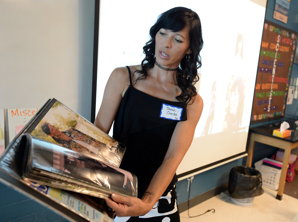 . BROOMFIELD, CO - October 2: Professional model, Sarah Clarke, shows students her portfolio. About 60 speakers talked to sixth, seventh and eighth grade students at Broomfield Heights Middle School for their annual career day.(Photo by Cliff Grassmick/Staff Photographer))