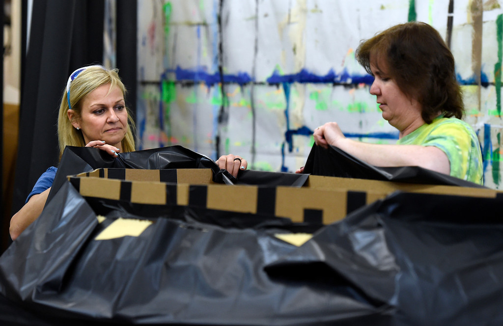 . Suzanne Steinhauer, at left, and Shelle Ferraro work to create a prop for a prom after party at the Broomfield High School JAM warehouse on Thursday in Broomfield. For more photos of the JAM preparation go to www.dailycamera.com Jeremy Papasso/ Staff Photographer April 13, 2017