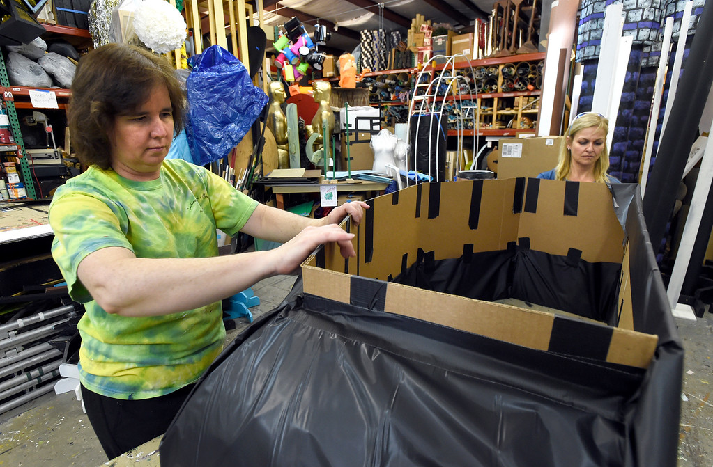 . Shelle Ferraro, at left, and Suzanne Steinhauer work to create props for a prom after party at the Broomfield High School JAM warehouse on Thursday in Broomfield. For more photos of the JAM preparation go to www.dailycamera.com Jeremy Papasso/ Staff Photographer April 13, 2017