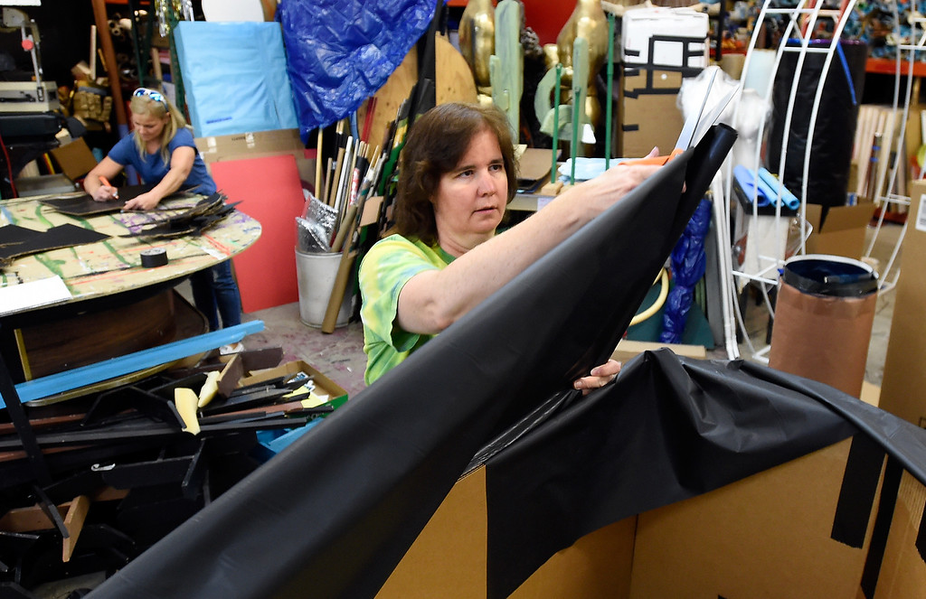 . Shelle Ferraro, at center, and Suzanne Steinhauer work to create props for a prom after party at the Broomfield High School JAM warehouse on Thursday in Broomfield. For more photos of the JAM preparation go to www.dailycamera.com Jeremy Papasso/ Staff Photographer April 13, 2017