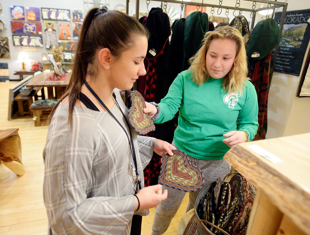 . BROOMFIELD, CO - November 23, 2018: Tori Sayers, left, and Kendal Chipperfield, shop at Cleveland Creek in Broomfield. Cleveland Creek (furniture/furnishings store) and Oil and Vinegar, both at Flatiron Crossing Mall, are getting ready Friday for Small Business Saturday.  (Photo by Cliff Grassmick/Staff Photographer)