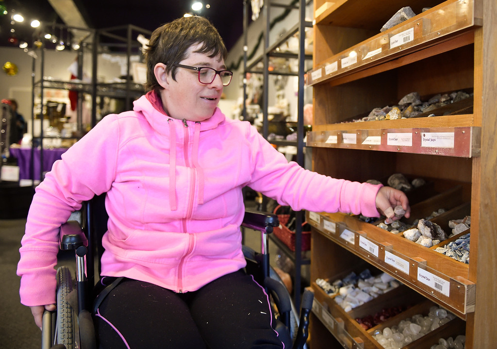 . Best1 LONGMONT, CO - NOVEMBER 23: Employee Mindy Johnson retrieves an itme for a customer at Crystal Joys Nov. 23, 2018. Crystal Joys is located at 340 Main St., Longmont. (Photo by Lewis Geyer/Staff Photographer)