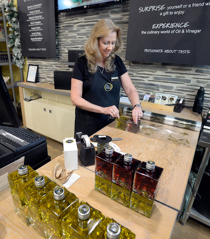 . BROOMFIELD, CO - November 23, 2018: DeAnn Hines makes gifts combos at Oil & Vinegar on Friday. Cleveland Creek (furniture/furnishings store) and Oil and Vinegar, both at Flatiron Crossing Mall, are getting ready Friday for Small Business Saturday.  (Photo by Cliff Grassmick/Staff Photographer)