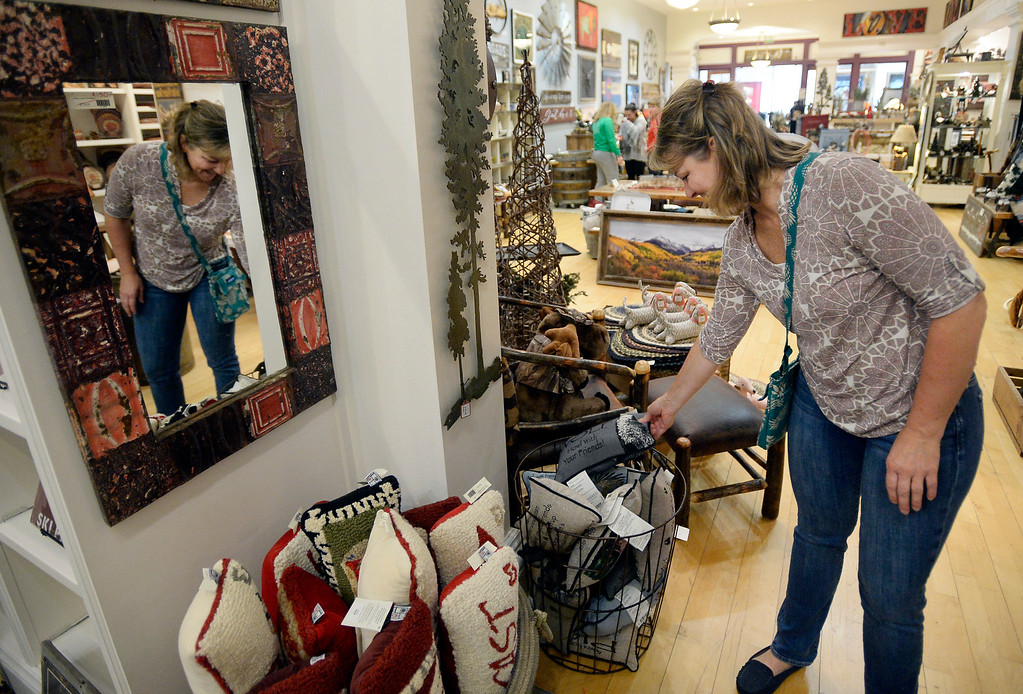 . BROOMFIELD, CO - November 23, 2018:  Laura Chipperfield looks at pillows at Cleveland Creek Home store. Cleveland Creek (furniture/furnishings store) and Oil and Vinegar, both at Flatiron Crossing Mall, are getting ready Friday for Small Business Saturday.  (Photo by Cliff Grassmick/Staff Photographer)