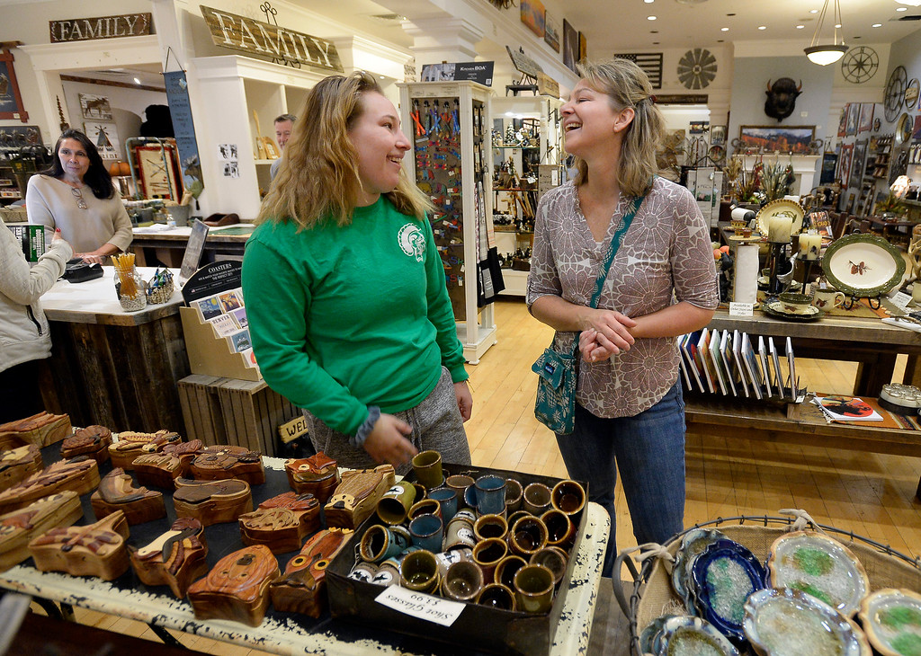 . BROOMFIELD, CO - November 23, 2018:Kendal Chipperfield, and her mother, Laura, look talk about gifts at Cleveland Creek Home store. Cleveland Creek (furniture/furnishings store) and Oil and Vinegar, both at Flatiron Crossing Mall, are getting ready Friday for Small Business Saturday.  (Photo by Cliff Grassmick/Staff Photographer)