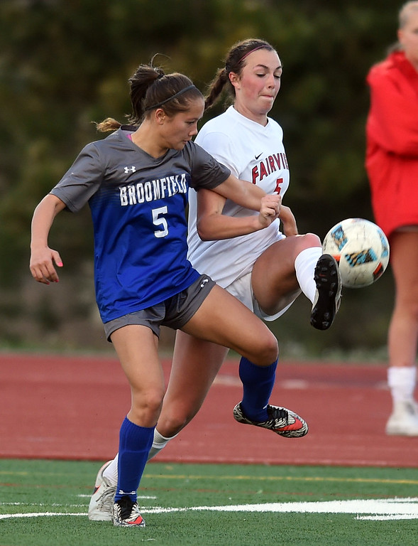 . Gia Lemley, of Broomfield, and Julia Masciarelli, of Fairview, battle for control on Tuesday. For more photos, go to www.BoCoPreps.com. Cliff Grassmick  Staff Photographer April 18, 2017