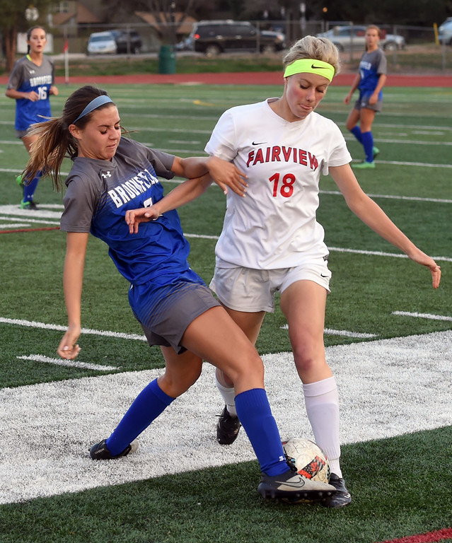 . Jordan Goodwin, left, of Broomfield, and Emma Carter, of Fairview, battle for control on Tuesday. For more photos, go to www.BoCoPreps.com. Cliff Grassmick  Staff Photographer April 18, 2017