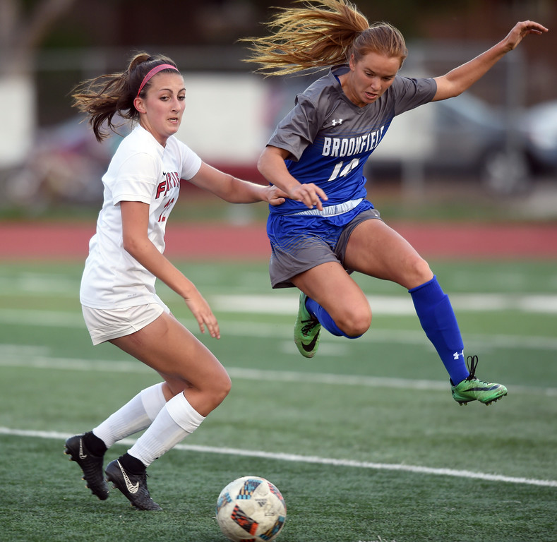 . Elle Webber, of Broomfield, flies past Brooke Berdan, of Fairview, on Tuesday.  For more photos, go to www.BoCoPreps.com. Cliff Grassmick  Staff Photographer April 18, 2017