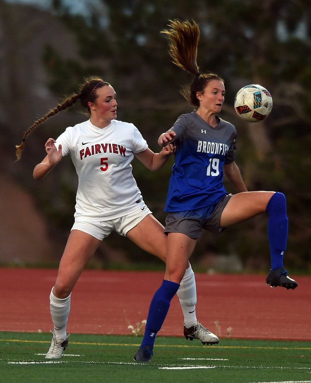 . Julia Masciarelli, left, of Fairview, and Hailey Stodden, of Broomfield, battle Tuesday night.  For more photos, go to www.BoCoPreps.com. Cliff Grassmick  Staff Photographer April 18, 2017