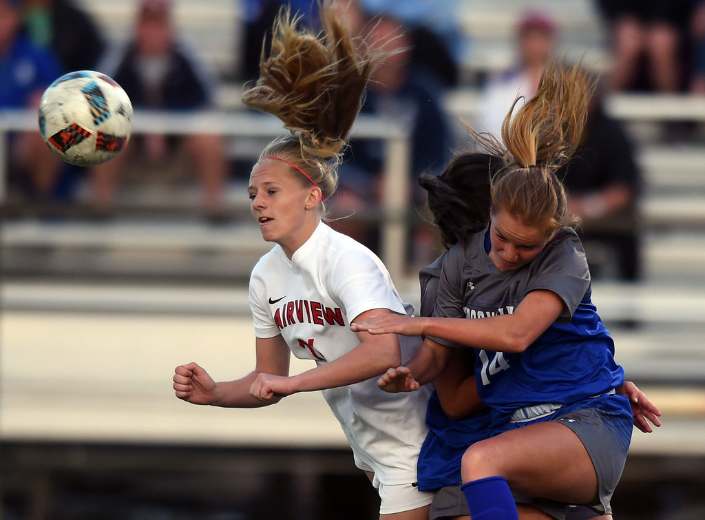 . Aspen Anderson, left, of Fairview, and Elle Webber, of Broomfield, battle Tuesday night.For more photos, go to www.BoCoPreps.com. Cliff Grassmick  Staff Photographer April 18, 2017