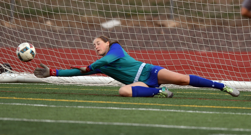 . Grace Fuller, of Broomfield, stretches out for a save against Fairview on Tuesday. For more photos, go to www.BoCoPreps.com. Cliff Grassmick  Staff Photographer April 18, 2017