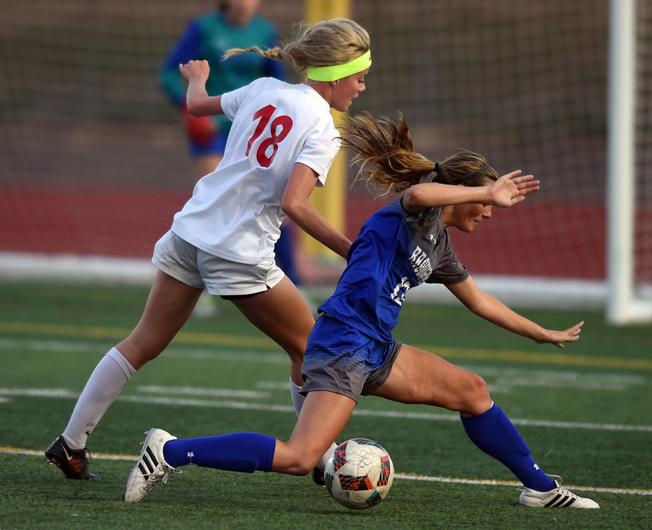 . Emma Carter, left, of Fairview, and Morgan Menees, of Broomfield, battle Tuesday night. For more photos, go to www.BoCoPreps.com. Cliff Grassmick  Staff Photographer April 18, 2017