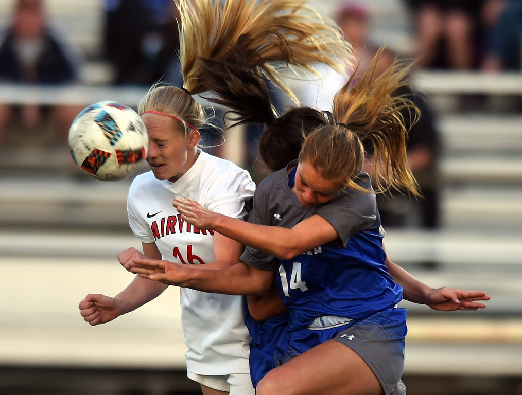 . Aspen Anderson, left, of Fairview, and Elle Webber, of Broomfield, battle Tuesday night. For more photos, go to www.BoCoPreps.com. Cliff Grassmick  Staff Photographer April 18, 2017