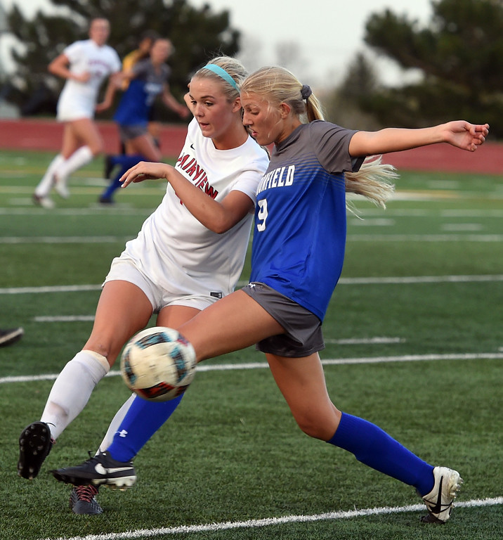. Tea Smith, left, of Fairview, and Marina Davidson, of Broomfield, battle Tuesday night. For more photos, go to www.BoCoPreps.com. Cliff Grassmick  Staff Photographer April 18, 2017