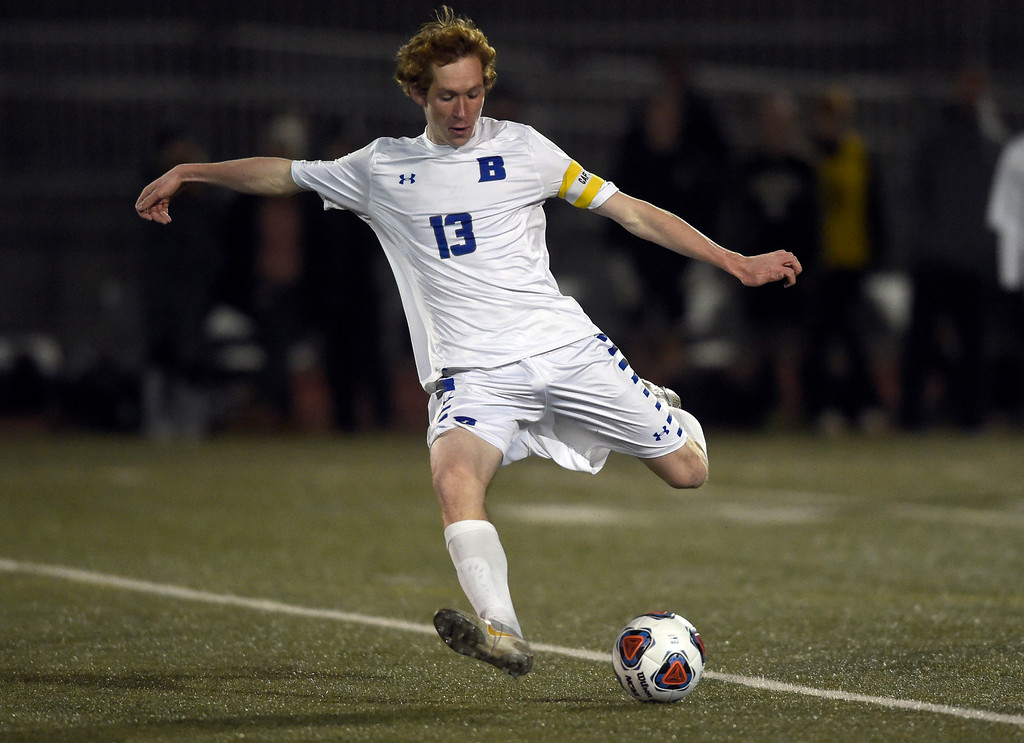 . PARKER, CO - NOVEMBER 7, 2018: Broomfield High School\'s Tanner Smith passes the ball upfield during a CHSAA 5A semi-final playoff game against Arapahoe High School on Wednesday at Echo Park Stadium in Parker. Broomfield lost 4-3. More photos: BoCoPreps.com