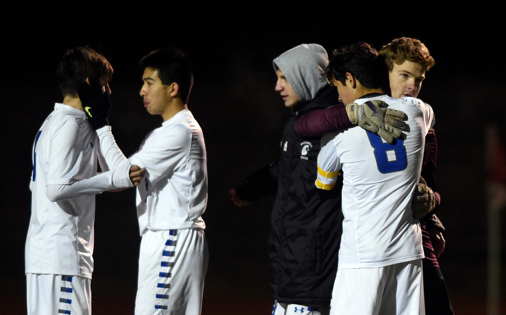 . PARKER, CO - NOVEMBER 7, 2018: Broomfield High School goalkeeper Kaden Carson, right, hugs teammate Nathan Dishongh after losing a CHSAA 5A semi-final playoff game against Arapahoe High School on Wednesday at Echo Park Stadium in Parker. Broomfield lost 4-3. More photos: BoCoPreps.com