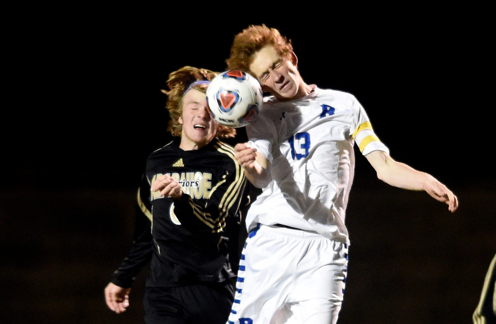 . PARKER, CO - NOVEMBER 7, 2018: Broomfield High School\'s Tanner Smith heads the ball over Ben Davis during a CHSAA 5A semi-final playoff game against Arapahoe High School on Wednesday at Echo Park Stadium in Parker. Broomfield lost 4-3. More photos: BoCoPreps.com