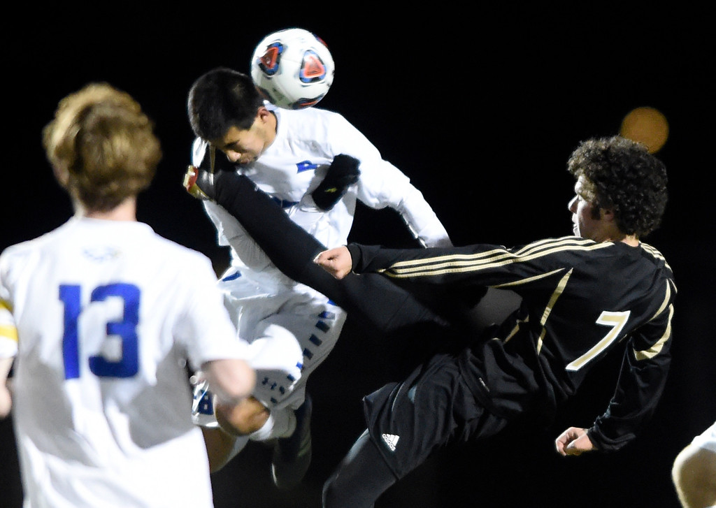 . PARKER, CO - NOVEMBER 7, 2018: Broomfield High School\'s John Luc-Harbour takes a kick to the face from Cameron Gail during a CHSAA 5A semi-final playoff game against Arapahoe High School on Wednesday at Echo Park Stadium in Parker. Broomfield lost 4-3. More photos: BoCoPreps.com