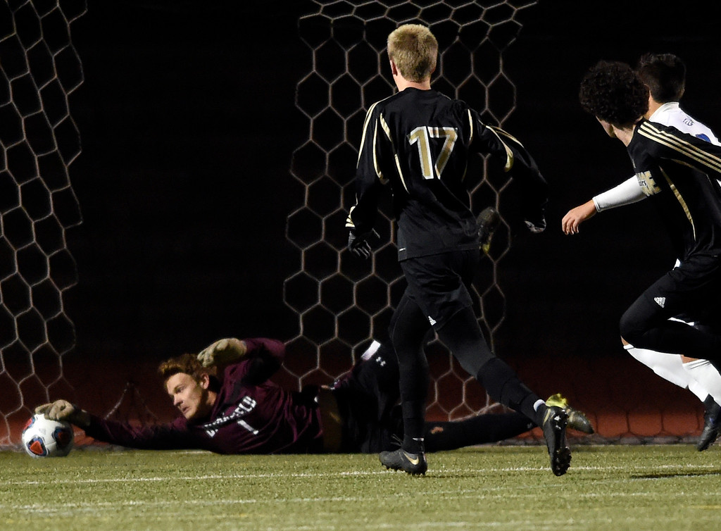 . PARKER, CO - NOVEMBER 7, 2018: Broomfield High School goalkeeper Kaden Carson makes a diving save during a CHSAA 5A semi-final playoff game against Arapahoe High School on Wednesday at Echo Park Stadium in Parker. Broomfield lost 4-3. More photos: BoCoPreps.com