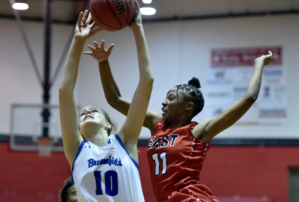 . BOULDER, CO - DECEMBER 4, 2018: Broomfield High School\'s Courtney Wristen takes a shot over Kiana Thompson during a game against Denver East on Wednesday during the Fairview Festival Tournament at Fairview High School in Boulder. More photos: BoCoPreps.com (Photo by Jeremy Papasso/Staff Photographer)