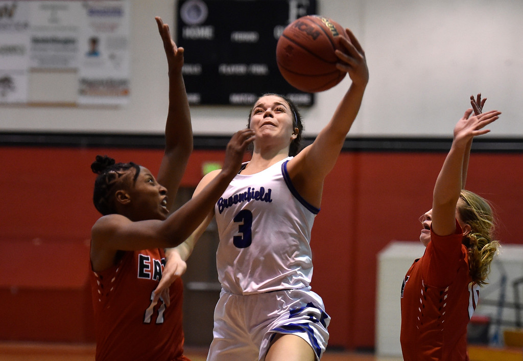 . BOULDER, CO - DECEMBER 4, 2018: Broomfield High School\'s Steph Peterson goes for a layup over Kiana Thompson during a game against Denver East on Wednesday during the Fairview Festival Tournament at Fairview High School in Boulder. More photos: BoCoPreps.com (Photo by Jeremy Papasso/Staff Photographer)