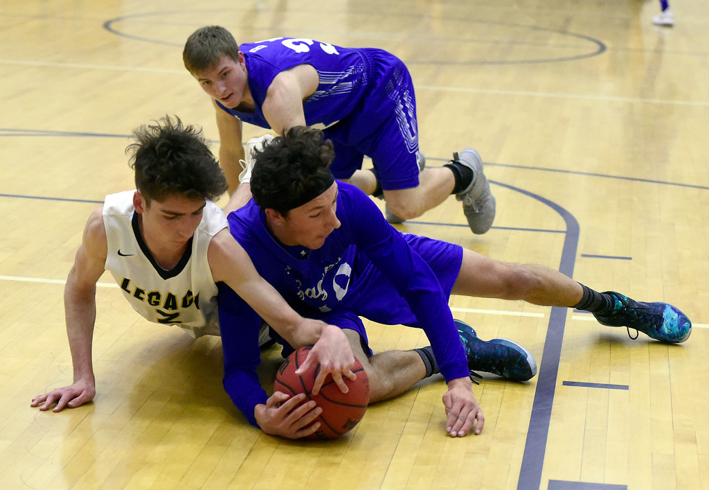 . Broomfield High School\'s Steve Croell fights for a loose ball with Zach Wagner during a game against Legacy on Tuesday in Broomfield. More photos: BoCoPreps.com Jeremy Papasso/ Staff Photographer 02/06/2018