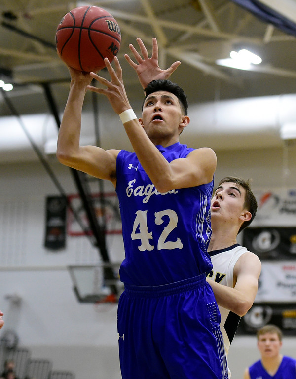 . Broomfield High School\'s Devin Martinez takes a shot in front of Jack Olsen during a game against Legacy on Tuesday in Broomfield. More photos: BoCoPreps.com Jeremy Papasso/ Staff Photographer 02/06/2018