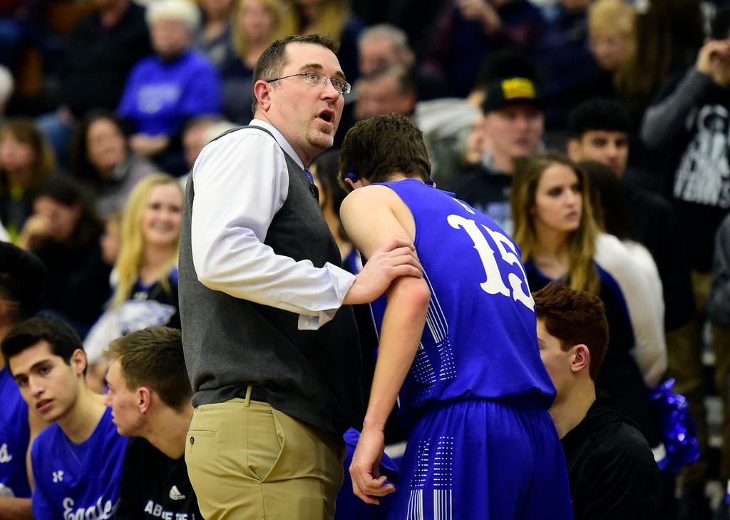 . Broomfield High School Head Coach Terrence Dunn talks with Michael Georgiton during a game against Legacy on Tuesday in Broomfield. More photos: BoCoPreps.com Jeremy Papasso/ Staff Photographer 02/06/2018