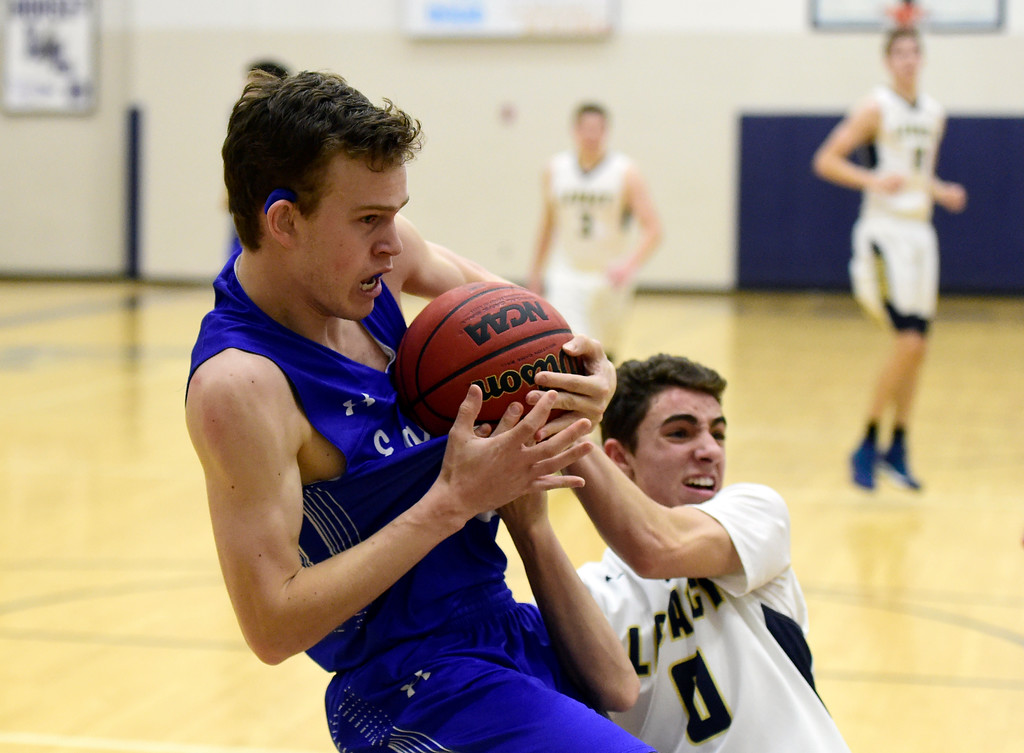 . Broomfield High School\'s Michael Georgiton fights for the ball with Jake Borelli during a game against Legacy on Tuesday in Broomfield. More photos: BoCoPreps.com Jeremy Papasso/ Staff Photographer 02/06/2018