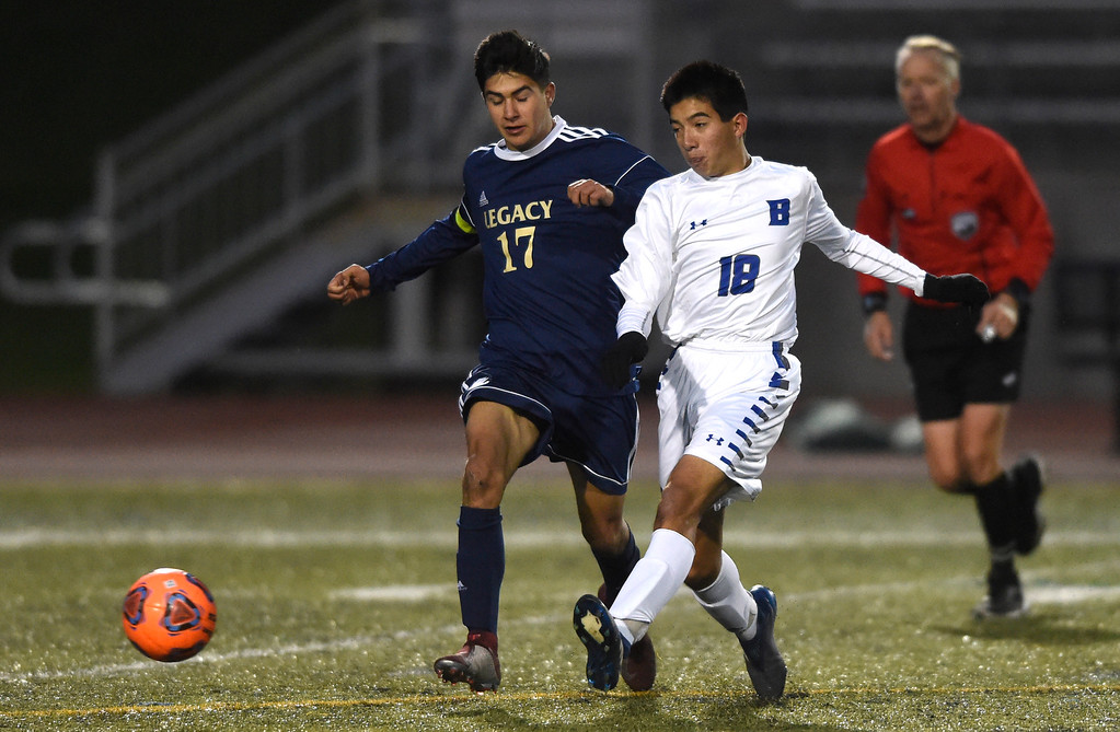 . WESTMINSTER, CO - OCTOBER 9, 2018: Broomfield High School\'s John Luc Harbour passes the ball past Joey Joiner during a game against Legacy on Tuesday at the North Stadium in Westminster. More photos: BoCoPreps.com (Photo by Jeremy Papasso/Staff Photographer)