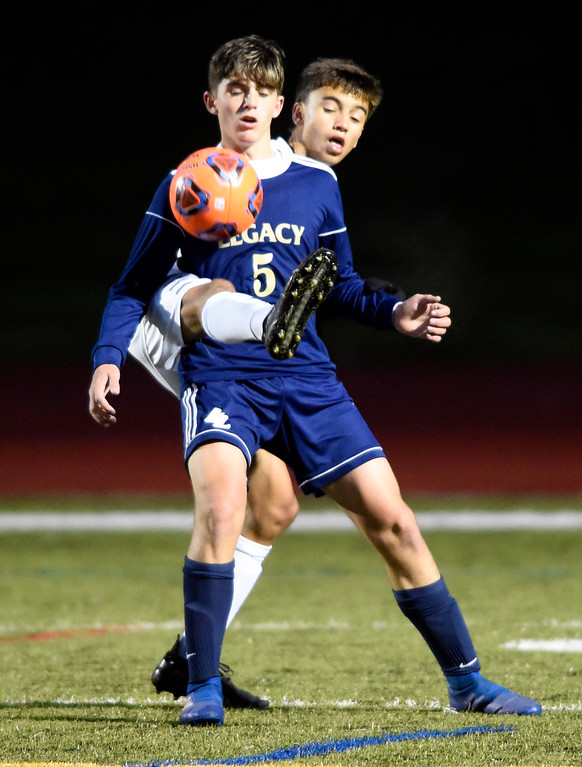 . WESTMINSTER, CO - OCTOBER 9, 2018: Legacy High School\'s Blake Hansen fights for the ball with Zane Jacobson during a game against Broomfield on Tuesday at the North Stadium in Westminster. More photos: BoCoPreps.com (Photo by Jeremy Papasso/Staff Photographer)