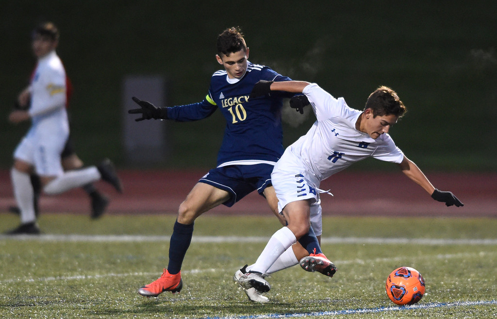 . WESTMINSTER, CO - OCTOBER 9, 2018: Broomfield High School\'s Andrew Boettcher fights for the ball with Noah Stover during a game against Legacy on Tuesday at the North Stadium in Westminster. More photos: BoCoPreps.com (Photo by Jeremy Papasso/Staff Photographer)