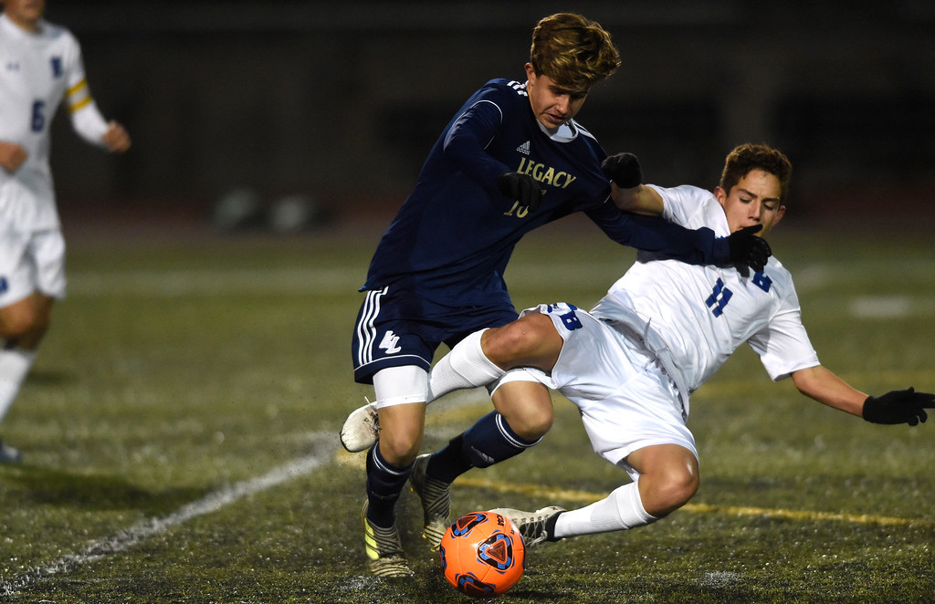 . WESTMINSTER, CO - OCTOBER 9, 2018: Broomfield High School\'s Andrew Boettcher fights for the ball with Andrew Sanchez during a game against Legacy on Tuesday at the North Stadium in Westminster. More photos: BoCoPreps.com (Photo by Jeremy Papasso/Staff Photographer)