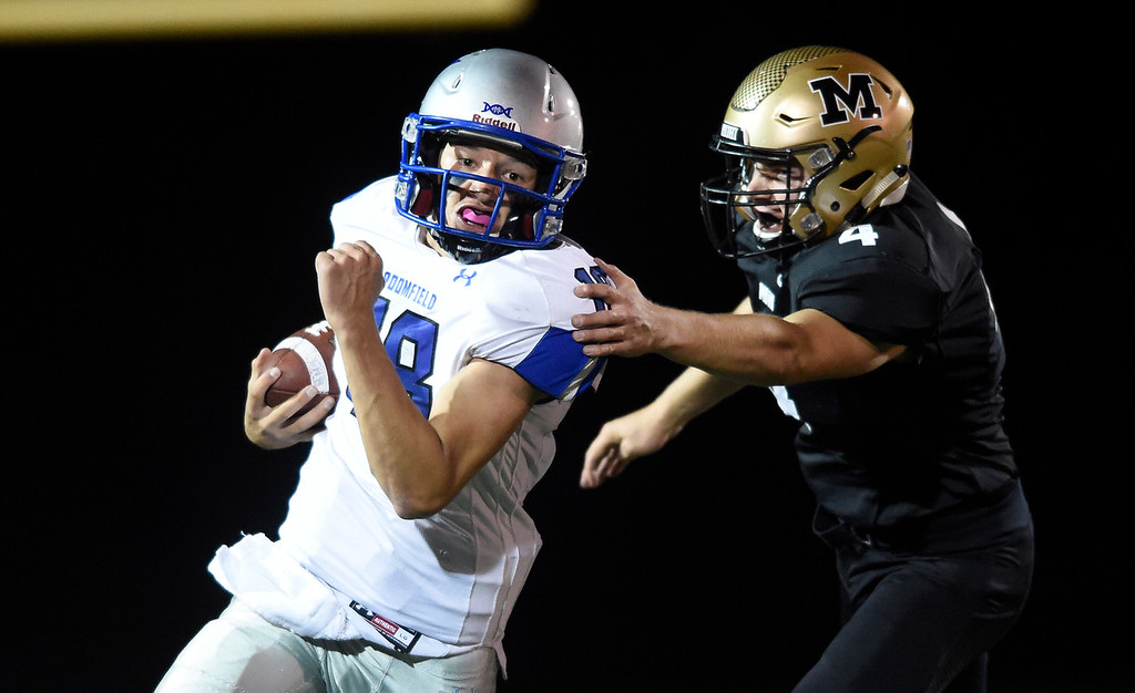 . LAFAYETTE, CO - SEPTEMBER 21, 2018: Broomfield High School quarterback Steven Croell breaks a tackle from Mason Kreiter  during a game against Monarch on Friday at Centaurus High School in Lafayette. More photos: BoCoPreps.com (Photo by Jeremy Papasso/Staff Photographer)