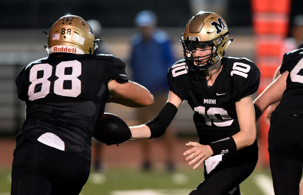 . LAFAYETTE, CO - SEPTEMBER 21, 2018: Monarch High School\'s Kyle Gordon hands off to Austin Fiala during a game against Broomfield on Friday at Centaurus High School in Lafayette. More photos: BoCoPreps.com (Photo by Jeremy Papasso/Staff Photographer)